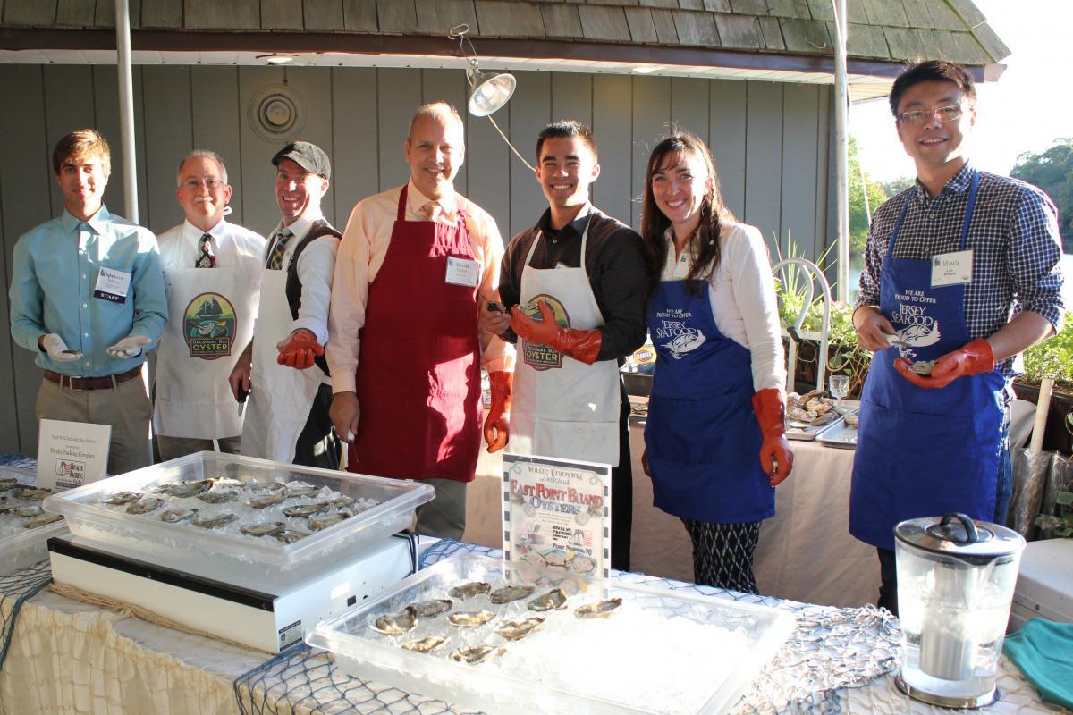 Volunteer oyster shuckers